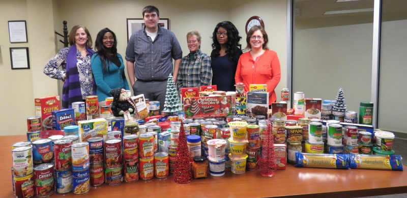 staff with food collected in food drive