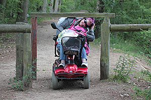 woman in wheelchair on a trail